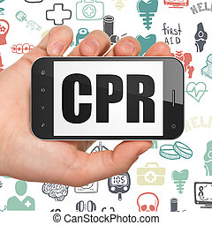 Medicine concept: Hand Holding Smartphone with CPR on...