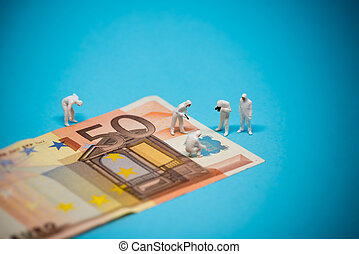 Specialists inspecting 50 euro banknote Fraud concept Macro...