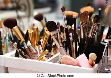 Cosmetics - Toilette table with boxes with cosmetic brushes