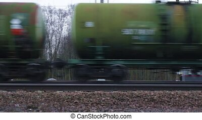 Freight train with petroleum tank - Railway carriages with...
