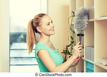 happy woman with duster cleaning at home - people, housework...