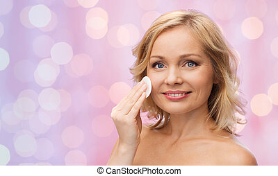 happy woman cleaning face with cotton pad - beauty, people...