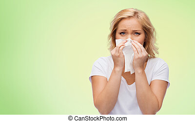 unhappy woman with paper napkin blowing nose - people,...