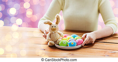 close up of woman hands with easter eggs and bunny - easter,...