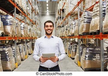happy businessman with tablet pc at warehouse - wholesale,...