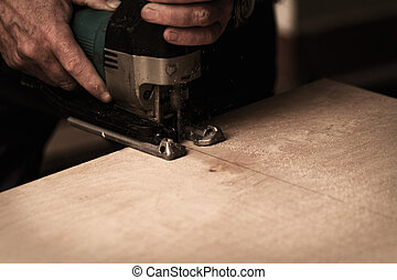 Fret saw - Photo of a man working with fret saw