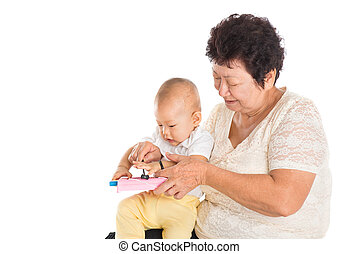 Grandmother playing with grandchild