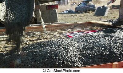 Concrete mixture flows to the plate - Concrete mixture flows...