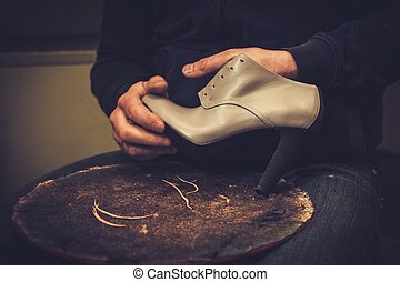Shoemaker performs shoes in the studio craft
