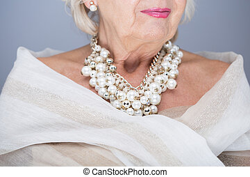 Royal lady needs jewellery - Senior woman with valuable...