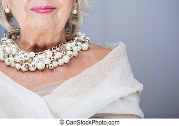 Beauty doesnt have age - Senior woman wearing precious pearl...