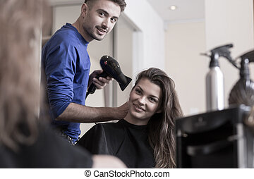 Smiling woman and her hairdresser - Beautiful smiling woman...