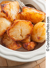 Roast Potatoes cooked in beef fat until crisp and golden a...