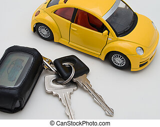 Car key ring and driving vehicle isolated on white