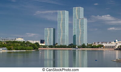 Yesil river timelapse with modern towers of residential...