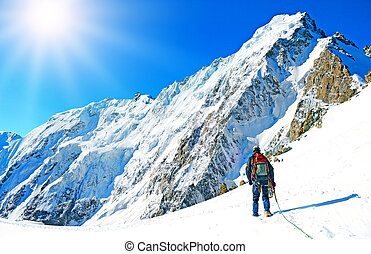 Climber reaching the summit of mountain