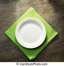 plate on green napkin