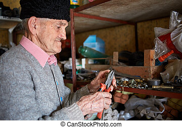 Old man in his tool shed - Senior man in his tool shed...