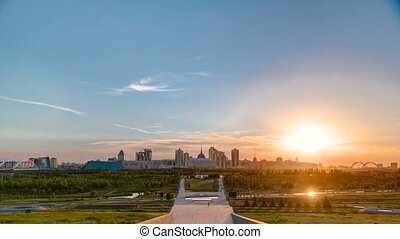 Panorama with sunset of the Astana city timelapse and the president's residence Akorda with park