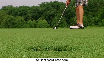 Golfer Sinks Putt 05 - Golfer sinks long putt.