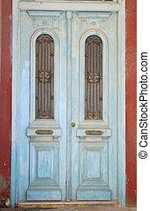 Door of an old building in Malia - Door of an old building...