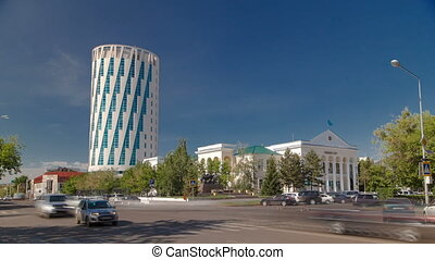 Exterior of the square next to the council of Astana city building with traffic on intersection in Astana, Kazakhstan.