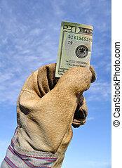 Worker Holding a Twenty Dollar Bill - Worker Wearing Leather...