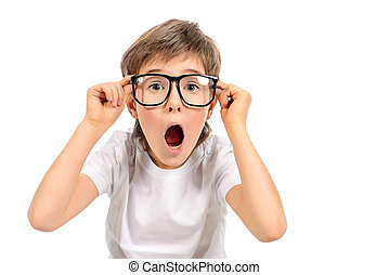 reaction - Surprised smart boy in big glasses staring at the...