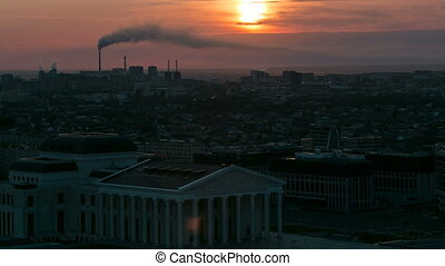 Elevated view with sunrise over the city center with State...