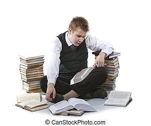 schoolboy in a school uniform sits - The schoolboy in a...