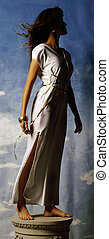 Grecian Pose - Woman on pedestal in a white Grecian toga...