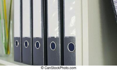 Office folders on a shelf 4K