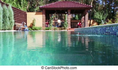 Swimming pool with water in garden - Bokeh pool in front of...