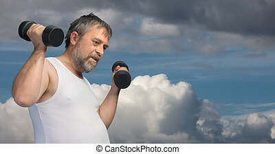 Fat middle-aged man exercising with dumbbells - Hard work...