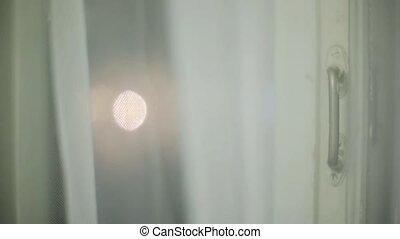 View of abstract light through white window tulle. - View of...