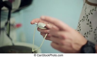 Man hands hold and then push button of old round stopwatch...