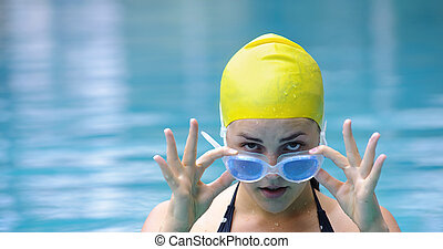 Blue and yellow - Female with goggles and swimming cap look...