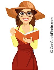 Woman with garden hat and glasses reading gardening journal