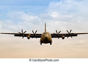 military cargo transporter in landing