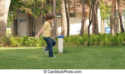 Funny kid run to catch the soap bubbles