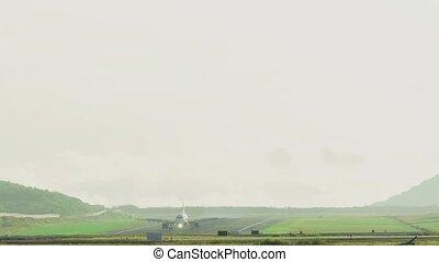 Airbus 320 braking after landing, early foggy morning,...