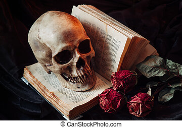 Still life with human skull, red roses and old book