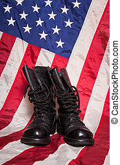 Combat Boots with Flag - A pair of combat foots with an...