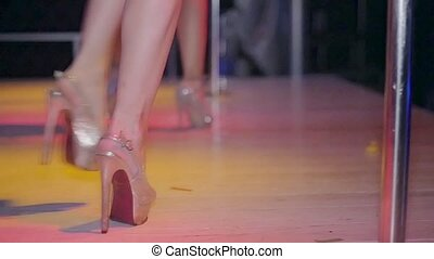 Dancing legs of go go dancer on high heels in nightclub Red...