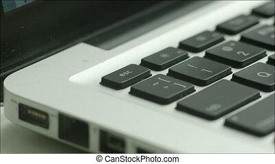 Pushing Escape Button on Laptop - Closeup shot of an escape...