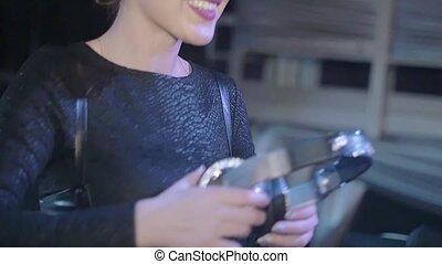 Dj girl in black top slam headphones at turntable. Nightclub. Slow motion.