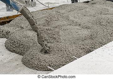 concrete - mixed concrete pouring at construction site