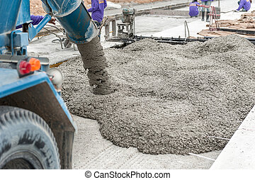 concrete - mixed concrete pouring at construction site