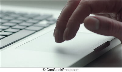 Using Touchpad of Laptop - Closeup shot of a laptop...