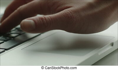 Human Hand and Touchpad and Keyboard of Laptop - Closeup...
